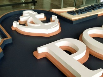 Wooden sign with 3D letters